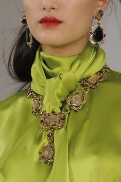 Love the fashion statement of having the large necklace and earrings with such a conservative blouse!