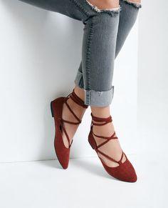 <p>These boho-inspired dorsay flats feature a faux suede upper, a braided lace-up design with metal eyelets, and a pointed toe.</p>    <ul>  <li>Lace-up Closure</li>  <li>Lightly Padded Footbed</li>  <li>Textured Sole</li>  <li>Man Made Materials</li>  <li>Imported</li>  </ul>