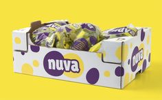 AGRICOPER, NUVA BRAND DEVELOPMENT.  A box of Nuva: the pattern of dots that comes from the shape and color of the grapes covers all materials.