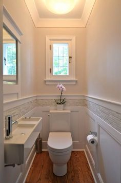 Small half bath - not a fan of the sink but LOVE the combo wall tile / woodwork.