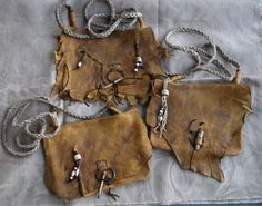Custom order for 3 heavy elk hide mountain man possibles bags with hand woven hemp straps. Raggedy & primitive, stained with walnut stained and weather proofed with bear grease. Closures of deer antler or coyote bone toggles. For a grandfather and grandsons. by Miss Tudy https://www.etsy.com/shop/misstudy