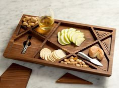 Puzzle Serving Tray Newton Vineyards commissioned Materious for the design of this unique, limited-edition serving tray. Called The Puzzle Tray it is made entirely of FSC-certified Walnut and its distinctive design relates directly to the story of the renowned St. Helena, California vineyard and the fine wines they produce.
