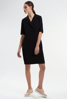 LUTALICA DRESS by PULSE Inspired bythe sleek elegance of the tuxedo, this dress has a masculine-inspired design. It's cut in a slightly loose silhouette for ease of movement and finished with sharp lapels. Concealed zipper along side. Material: Wool-blend felt 60% Wool 40% Polyester Colour: Black Size: EU 34 - US 2 to EU 44 - US 12 Care: Dry clean.