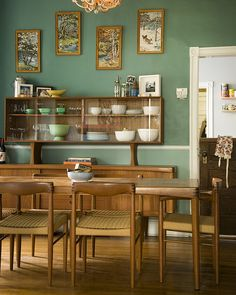 Mid-century Modern dining room. Love everything--the Danish dining set with china cabinet, the Dutch door and the paint by number paintings on the green wall
