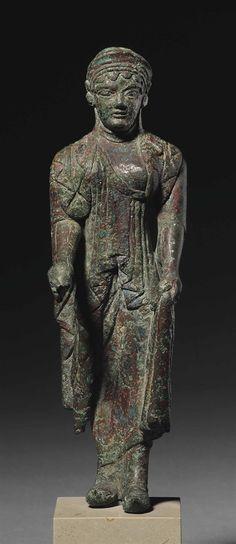 AN ETRUSCAN BRONZE KORE -  ARCHAIC PERIOD, CIRCA 500-480 B.C.