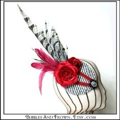 http://www.kaboodle.com/reviews/requiem....-fascinator-black-white-and-red-with-feathers-and-cameo