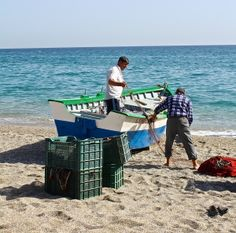 local fishermen getting their nets ready