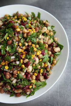 Healthy 5-Bean Salad calls for 1 can whole-kernel corn, 1 can each kidney beans, garbanzo beans, pinto beans, cannellini beans & black-eyed peas, olive oil, onion, vinegar, sugar, salt, pepper, cilantro & oregano