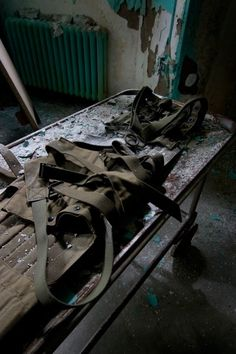 Restraints in an abandoned asylum - because who doesn't like creepy abandoned asylums.
