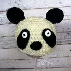 Panda Bear Hat. Made from 100% soft acrylic yarn and plastic buttons for the eyes (please leave note if you would like no buttons). Sizes: 0-3 months, 3-6 months, 6-9 months, 9-12 months, Toddler, Child, Teen/Adult  Machine washer and dryer safe  Made in a smoke free home  Thanks to Sarah from Repeat Crafter Me for the hat pattern