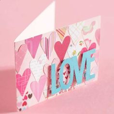 Simple Hearts Valentine Card - Your love will stand out with this valentine. Simply punch hearts from patterned scrapbook paper and arrange the hearts on a folded piece of pink cardstock. Cut the letters from teal cardstock and adhere them using adhesive foam.