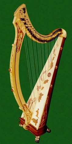 Carved and painted Celtic harp. ahhhh! can I have it please????