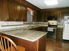 dark kitchen cabinets backsplashes | ST. CECILIA Granite on Dark Cabinets traditional kitchen