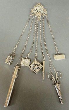 English silver chatelaine with scissors, thimble, pen, etc.