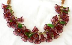 Vintage Early Miriam Haskell Style Celluloid Bell-Shaped Beads & Leaves Silk Cord Necklace. $150.00, via Etsy.