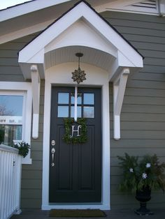 Exterior paint color hardware...Sherwin Williams. Love the painted Craftsman door with the nickel hardware.
