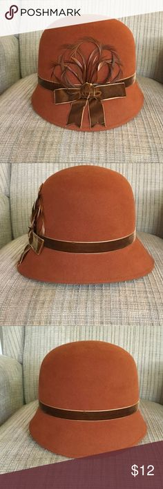 Plaza Suite New York cloche camel hat Camel orangey-brown hat with ribbon and feather detail, satin lined with adjustable interior for better fit (see photos). Only worn twice, in excellent condition Accessories Hats