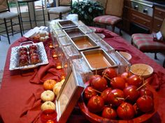 Candy apple bar! Perfect our fall/halloween bash! Would make a HUGE mess, but would be fun.