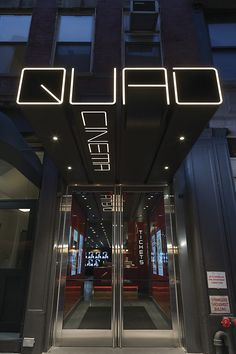 QUAD Cinema in Manhattan with custom exterior signage fabricated by DCL. Design by Pentagram. Wayfinding Signage, Signage Design, Facade Design, Exterior Design, Parking Design, Exterior Signage, Entrance Signage, Exterior Shutters, Stucco Exterior