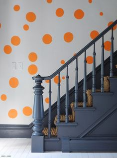 Painted stairs in charcoal with gray painted floors. Orange polka dot wallpaper from Adlephi Paper Hangings. Stairs with sisal runners. Our modern take on a Victorian home. Painted Staircases, Painted Stairs, Painted Floors, Spiral Staircases, Curved Staircase, Modern Staircase, Banisters, Stair Railing, 4 Wallpaper