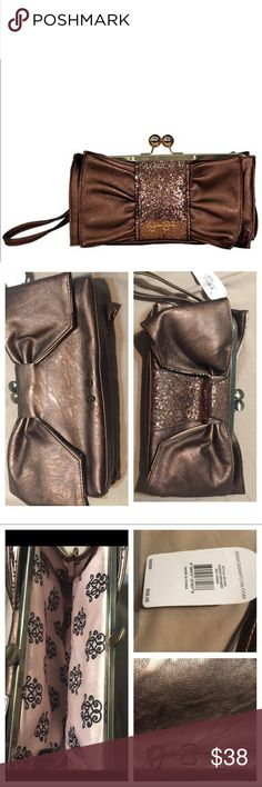 NWT Bronze Glitter J Simpson Clutch Purse Beautiful bronze bag. Perfectly New with tags. Never used. I love this bag but I need the room in my closet. Has a bow/ribbon design. Brownish color, leathery exterior Jessica Simpson Bags Clutches & Wristlets