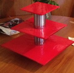 DIY cupcake stand made out of poster board and soup cans, and a can of water chestnuts on the bottom!