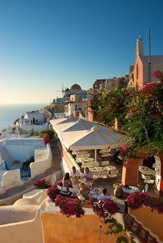 Cafe in Oia, Santorini, Greece #greecetravel