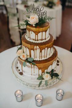 Aluscious Caramel drip semi naked wedding cake with fresh flowers by Lorelie @weddingcakesforyou.com