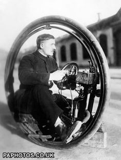 "Transport - One Wheel Motorcycle - Milan - 1922 - 1923 Signor Davide Cislaghi with his one wheel motorcycle called the ""Monowheel"" which is capable of speeds up to 40 mph. The trials have proved a success and the machine will soon be on the market."