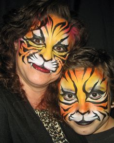 Tigress and Cub - Face painting by Mark Reid and Lisa Morales.  www.apinchofwonderful.com