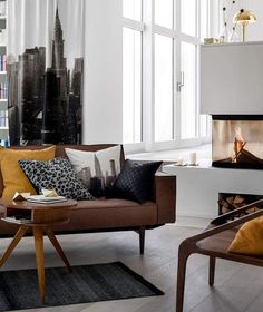 New York Loft Apartment Ideas Brown leather sofa mustard cushions