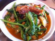 """Pinakbet is a popular Ilokano dish, from the northern regions of the Philippines, although it has become popular throughout the archipelago. The word is the contracted form of the Ilokano word pinakebbet, meaning """"shrunk"""" . The original Ilokano pinakbet uses bagoong, of fermented monamon or other fish, while further south, bagoong alamang is used. The vegetables used in this dish include native bitter melon, eggplant, tomato, okra, string beans, chili peppers, parda, winged beans, and others"""