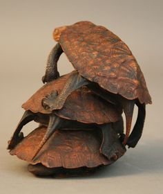 http://www.onlinegalleries.com/art-and-antiques/detail/a-japanese-carved-boxwood-group-of-turtles/110573