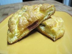 GUILT-FREE HAM AND CHEESE OR CHOCOLATE (CONSOLIDATION) CROISSANTS 3 large eggs 1 pinch cream of tartar 1/2 t Splenda 3 ounces fat free or low fat cream cheese 6 slices low fat ham 1 cup fat free cheddar, shredded OR 2 ounces bittersweet chocolate, coarsely chopped Preheat the oven at 300.   Separate the eggs and add sweetener, a pinch of salt, and cream cheese to the yolks. Use a mixer to combine the ingredients together.  In a another bowl, whip egg whites and cream of tartar until stif...