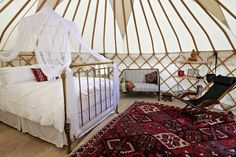 Roundhouse Yurts luxury Glamping Spanish Art Deco Brass bed