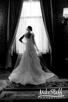 There is a pair of french doors in the bridal suite that I think would give the same type of effect shot.