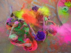 Picture of kids throwing colored powder during Holi, India