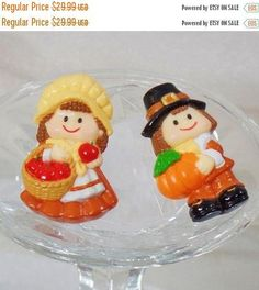 This #vintage pair of pilgrims brooches is absolutely adorable!  It features a pilgrim boy holding an orange pumpkin, and another pin featuring a pilgrim girl holding a bask... #ecochic #etsy #jewelry #jewellery