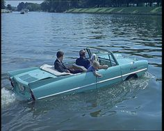 An amphibious car goes for a drive in the Thames (1963): http://www.britishpathe.com/video/water-car