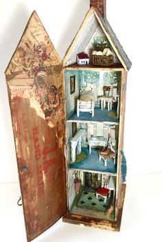 Made from a very old cigar box originating from Boston, Massachusetts, Stewart House measures a tall 8(length/base) x 6.25(width/base) x