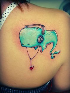 It's always nice when people smile at you as you walk away, and we think this tat gets that a lot! It's an original idea with the whale figure.. still really adorable!