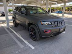 2017 Jeep Grand Cherokee Altitude with matte black vinyl wrap and red caliper covers.