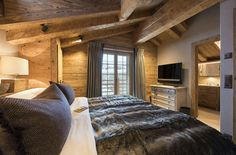 Comprising two interconnecting chalets and with over 900m² of internal floor space, this is truly a spectacular chalet. With its uninterrupted views of Mont Blanc Massif, the chalet has a large terrace with al fresco dining for 20, plus sofas and sun loungers, a sunken outdoor hot tub and vast fire pit with BBQ rack. Designed and furnished by a leading interiors specialist, the two sitting rooms and nine bedrooms are decorated with herringbone tweeds, faux fur throws and feature reclaimed…