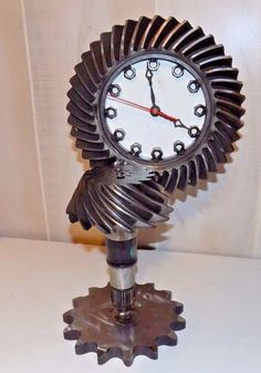 http://www.ebay.de/itm/Modernist-Industrial-Handmade-STEAMPUNK-SCULPTURE-Gear-Sprocket-Mix-Media-Clock/142518310352?hash=item212ec0d5d0:g:48MAAOSwhlZZyRQ3