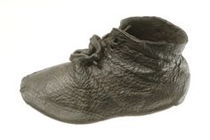 AD 1366 -1500, Medieval leather shoe. Child's ankle shoe with front laced. The upper part of the shoe is made on one piece of leather. This shoe was found at: Town ditch, Aldersgate Street, London.