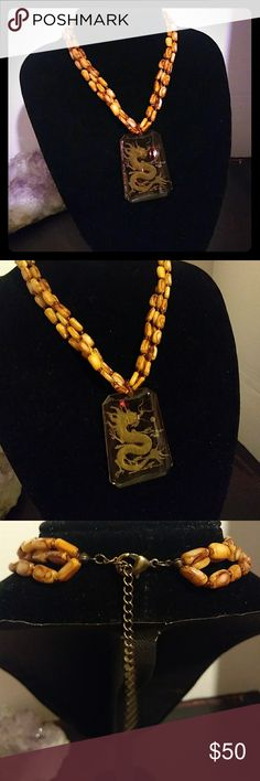 "VNT- Etched Amber Glass Dragon Pendant/Necklace Very cool etched Amber glass pendant w very detailed dragon design.. My camera isn't picking up just how insanely detailed this pc is. Triple strand creamy tannish/brown beaded necklace measures approx 14.5"" w an additional 3"" extender.. (approx 17.5"" total) Excellent vintage condition!! Feel free to ask any questions💕 Comes w gift box🎁 Vintage Jewelry Necklaces"