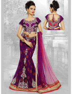 Innovative Net Purple Lehenga Choli Item code : GAA666P   http://www.bharatplaza.in/new-arrivals/lehengas/innovative-net-purple-lehenga-choli-gaa666p.html  Innovative purple color brocade inner net kalidar lehenga with matching raw silk choli is garlanded with shiny jardozy, diamantes, stones, cutdana, resham work motifs and fancy patch on skirt part bottom part gives you a mind blowing and heart catching looks. Paired with shaded dupatta with multi fancy patch border and trendy latkan.