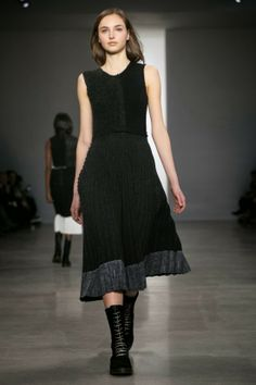 via Not Dead Yet Style -- Calvin Klein, runway look. Terrific contrast hem, pleated knit, separate top/skirt. @Rose White