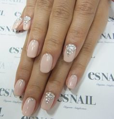 Nude and diamanté nail art
