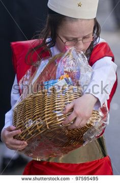 JERUSALEM - MAR. 09 : Ultra Orthodox costumed boy holding Mishloach Manot during Purim in Mea Shearim Jerusalem on Mar. 09 2012 , Mishloach Manot is traditional food gifts given during Purim